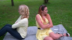 Two girlfriends quarrel in the park Stock Footage