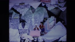 1967: cute dolls put amid fashion dresses and a huge magnificent building Stock Footage