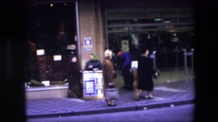 1967: a man is talking to a woman that is selling lottery tickets BRUSSELS Stock Footage