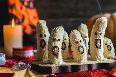 Homemade halloween scary banana ghosts monsters with chocolate faces. Kuvituskuvat