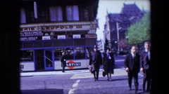 1967: people are walking on the road near to a shop CALAIS, FRANCE Stock Footage