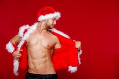 Sexy muscular man in santa uniform. Christmas New Year Stock Photos