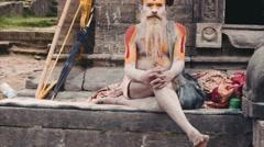 Group of Sadhu sitting, laying and meditating near Pashupatinath temple Stock Footage