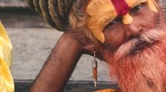 Sadhu laying and meditating near Pashupatinath temple. Kathmandu Nepal Stock Footage