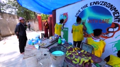 Greenpeace activists painting the banner in the street of Kathmandu Stock Footage