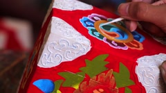 Nepali craftsman drawing Hindu style ornaments on the casket Stock Footage