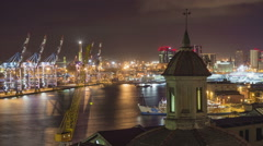 A sunset time lapse of the port of Genoa Stock Footage