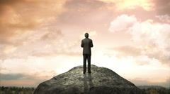 Break the concrete wall. Businessman standing in front of cliff. Stock Footage