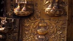 Gold prayer window with bas-relief of Buddha on Swayambhunath stupa Stock Footage