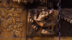 Gold prayer window with bas-relief of Buddha on Swayambhunath stupa Stock Footage