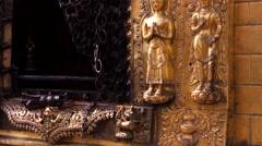 Gold prayer window with set of Shiva, Buddha, Garuda statues and bas-reliefs Stock Footage