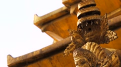 Gold prayer window with Shiva, Buddha, Garuda statues on Swayambhunath stupa Stock Footage