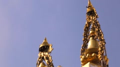 Golden Nepal Flag on Swayambhunath temple and bronze prayer wheels Stock Footage