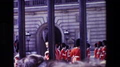 1969: old-fashioned dressed soldiers awaiting lined up in a courtyard LONDON Stock Footage