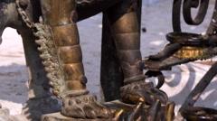 Spinning prayer wheels. Bronze Guardian lion statue Stock Footage