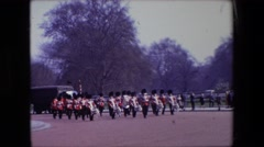 1969: british security walking down the street LONDON, ENGLAND Stock Footage
