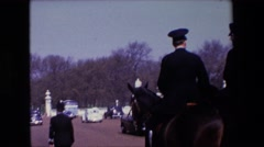 1969: a british policeman walks down a city street  Stock Footage