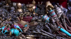 Gift shop with traditional souvenirs at the street (masks, statuettes) Kathmandu Stock Footage