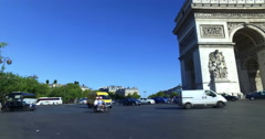 Traffic around Arch of Triumph on a sunny day in Paris, France. Camera movement. Stock Footage