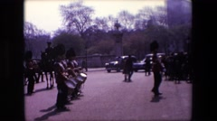 1969: group of people in red and black uniforms marching  Stock Footage