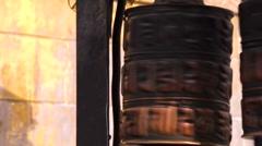 Spinning prayer wheels. Bronze Guardian lion statue. Kathmandu, Nepal Stock Footage