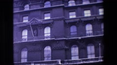 1969: zoom in on historic multi-room building with statue LONDON, ENGLAND Stock Footage