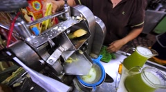 Process of extracting the juice from raw sugarcane using technology press. KL Stock Footage