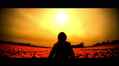 Child Walking Through A Field Of Flowers Stock Footage
