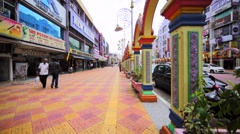 Walking along the street at Little India Brickfields in Kuala Lumpur, Malaysia Stock Footage