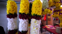 Close view of amazing colourful flower garlands at Kuala Lumpur street market Stock Footage