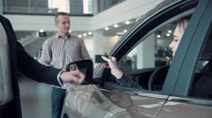 Sales Manager Gives the Client the Keys From the Car Stock Footage
