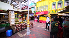 Walking in Old Market in KL. View of market stands with food, water and fruit Stock Footage