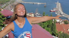 American tourist enjoying the sun and the ocean standing on the mountain lifesty Stock Footage