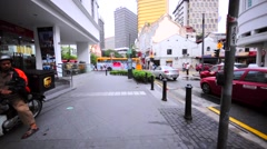 Walking in KL downtown along the road. Streets, public transport, buildings Stock Footage