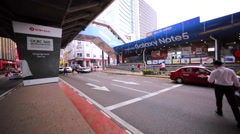 Panoramic view of the road with pedestriands in Kuala Lumpur downtown. Malaysia Stock Footage
