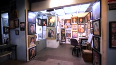 Beautiful portraits are sold in special pavillion in Kuala Lumpur downtown. Stock Footage