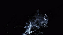 Messy puff of crisp smoke dissipating into black studio shot Stock Footage