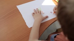 Boy Draws a Picture of House, Sitting at the Table Stock Footage