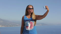 The American traveler photographed themselves on the background of ocean Stock Footage
