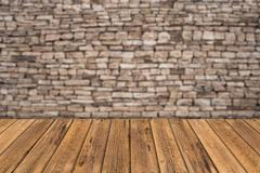 Stone wall background with wooden slats floor Stock Photos