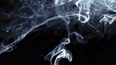 Wispy smoke filling top of screen shot in studio Stock Footage