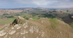 Aerial over a rocky cliff peak at Te Mata Peak, New Zealand Stock Footage