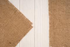 Burlap texture on wooden table background Stock Photos