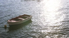 Wooden Boats on the sea ,sunlight reflection on water. Stock Footage