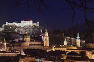 Salzburg and castle Hohensalzburg at night - Austria Stock Photos