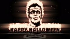 Burning Frankenstein face with text Happy Halloween Stock Footage