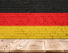 Germany flag painted on brick wall with wooden floor Piirros