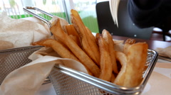Close up woman prepare eating fries at A&W restaurant Stock Footage