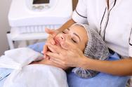 Beauty woman having cosmetic massage Stock Photos