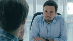 Job interview. Manager, boss in office talking with an applicant. Over the Stock Footage